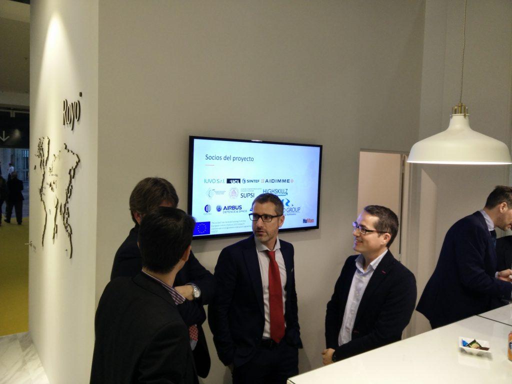 visitors listen to Royo's R&D Director, César Taboas